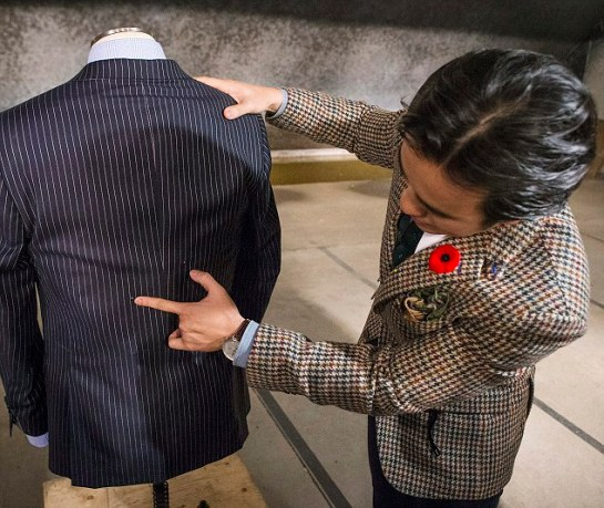 Michael Nguyen showing off the bullet proof suit and bullet holes made during a test run in Toronto.